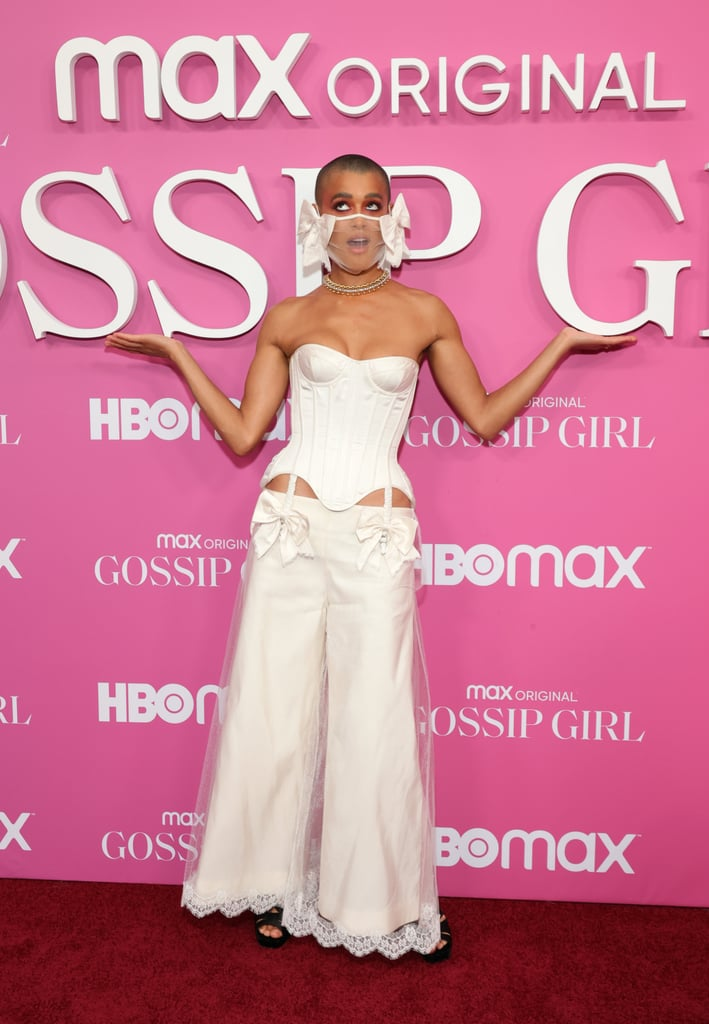 Jordan Alexander went above and beyond with her red carpet outfit for the Gossip Girl premiere. On Wednesday, the actress made a statement wearing a Wiederhoeft bridal ensemble. If you think you've seen the return of low-rise pants, think again. Jordan's look takes the trend to another level. Your eyes are instantly drawn into her detailed face mask, but take a little time to absorb the details, and you'll appreciate the sophistication and sexiness of her corset, suspenders, and trousers.   It seems only appropriate that Jordan brings together high fashion and the trends of the early '00s, since that's when the original Gossip Girl series premiered. Judging from the peeks of the reboot we've seen so far, the show's style will echo the greatness of its originator. Something tells us Blair Waldorf would be proud of the chic fashion risk Jordan took for the premiere — get a glimpse of the outfit from all angles in the photos ahead.       Related:                                                                                                           We Already Know There's a Stylish Serena van der Woodsen Easter Egg in the Gossip Girl Reboot