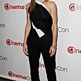 At a CinemaCon press conference, Sandra Bullock fed into the black-and-white trend in her Roland Mouret one-shoulder top and black trousers, complete with pointy Rupert Sanderson pumps.