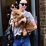 On Monday, Miley Cyrus carried her new puppy through the streets of NYC.