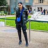 This fashion influencer proves a vest can look a bit edgier when styled with the right accessories. Take a closer look at her boot sneakers and furry strapped bag.