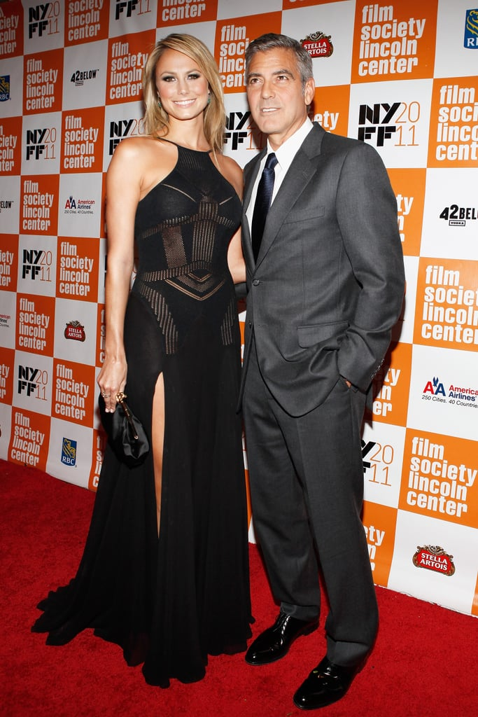 George Clooney and his girlfriend, Stacy Keibler, hit the red carpet last night at the New York Film Festival premiere of his new movie The Descendants. The event marked the first time George and Stacy attended a red carpet screening side by side — while she was in both LA and Toronto for debuts of The Ides of March, she didn't pose for photos with him in either city. This time, though, George and Stacy were attached at the hip. Everything must have gone great during George and Stacy's recent vacation in Cabo, which was timed to coincide with her 32nd birthday. In honor of the milestone, we took a look at Stacy Keibler's best bikini moments! George's directorial effort The Ides of March stuck near the top of the weekend box office at fourth place, but he's now turning his attention to Alexander Payne's Descendants ahead of its release in the US on Nov. 18.