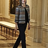 Queen Letizia went with a neutral-toned metallic striped bolero jacket over her all-black business outfit at a meeting with the Royal Board on Disability Council in October 2015.