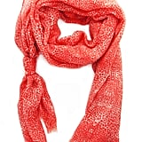 Kelly Wearstler's Coral Fragment Scarf ($175) is the easiest way to add a pop of interest to your mom's look.