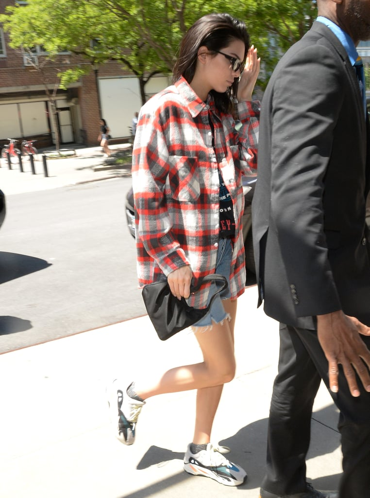 Kendall went peak '90s in May 2018, wearing her Prada piece with a grunge-inspired plaid shirt and dad sneakers.