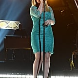 Kelly Clarkson performed in a blue dress.