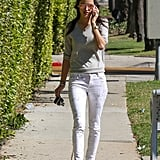 Rather than stark white skinnies, she picked a lightly printed pair and flat lace-up shoes. She sported serious mirrored statement sunglasses as the finishing touch.