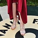 Patricia Clarkson completed her silky red dress with strappy gold sandals at the Vanity Fair Oscars afterparty.