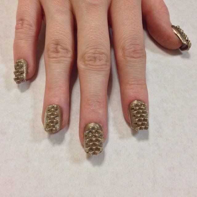 """Kingdom"" nails printed in brass.  Source: Instagram user thelasergirls"