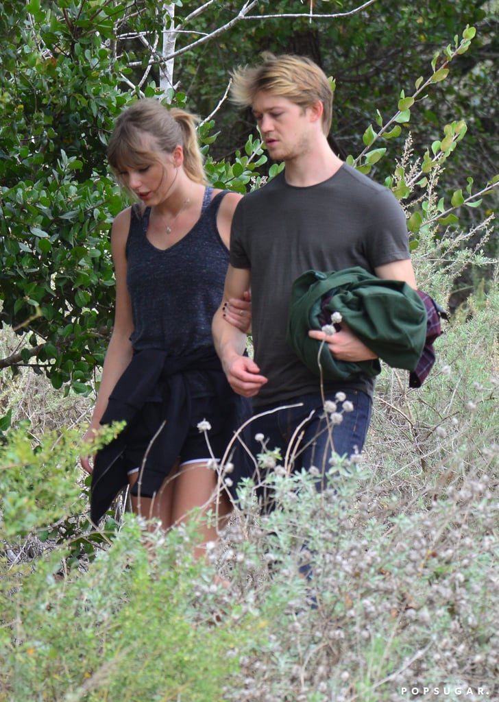 "Taylor Swift and Joe Alwyn are still going strong! On Wednesday, the incredibly private couple made a rare outing when they were spotted hiking in Malibu, CA. While the British actor dressed in jeans and a t-shirt, Taylor wore a tank top, Nike sneakers, shorts, and her signature silver necklace with Joe's initial, which she references in her song ""Call It What You Want."" The pair kept close during their hike; the ""End Game"" singer held on to her boyfriend's arm for support, and the couple held hands while walking up a hill.  E! Online reports that the two ""seemed very relaxed"" during their scenic hike. ""They appeared very comfortable in one another's company and seemed to be enjoying their time together — despite having a bodyguard following their every move,"" the insider added. ""They were deep in conversation for most of the hike and their attention was focused solely on one another."" The two have certainly shied away from the spotlight since they first started dating in May 2017. The last time they were spotted together was in December, after Taylor's Z100 Jingle Ball performance in NYC. Since then, the singer has been busy rehearsing for her upcoming Reputation world tour. She's even set to release her music video for ""Delicate,"" which is rumored to be about Joe, at the iHeartRadio Music Awards this weekend.       Related:                                                                                                           A Timeline of Taylor Swift and Joe Alwyn's Superprivate Romance"