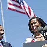 Barack smiled as he watched Michelle speak to the crowd.