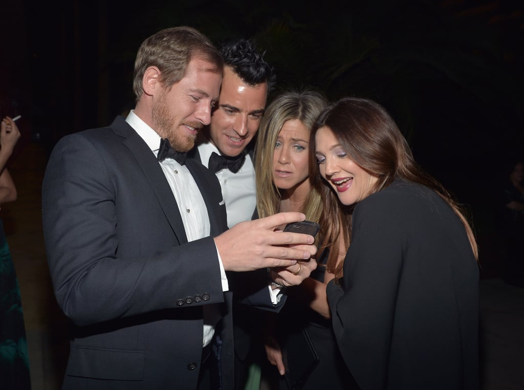 Jennifer Aniston and Justin Theroux shared a cute moment with Drew Barrymore and her husband, Will Kopelman, at LACMA's Art and Film Gala in LA in October.