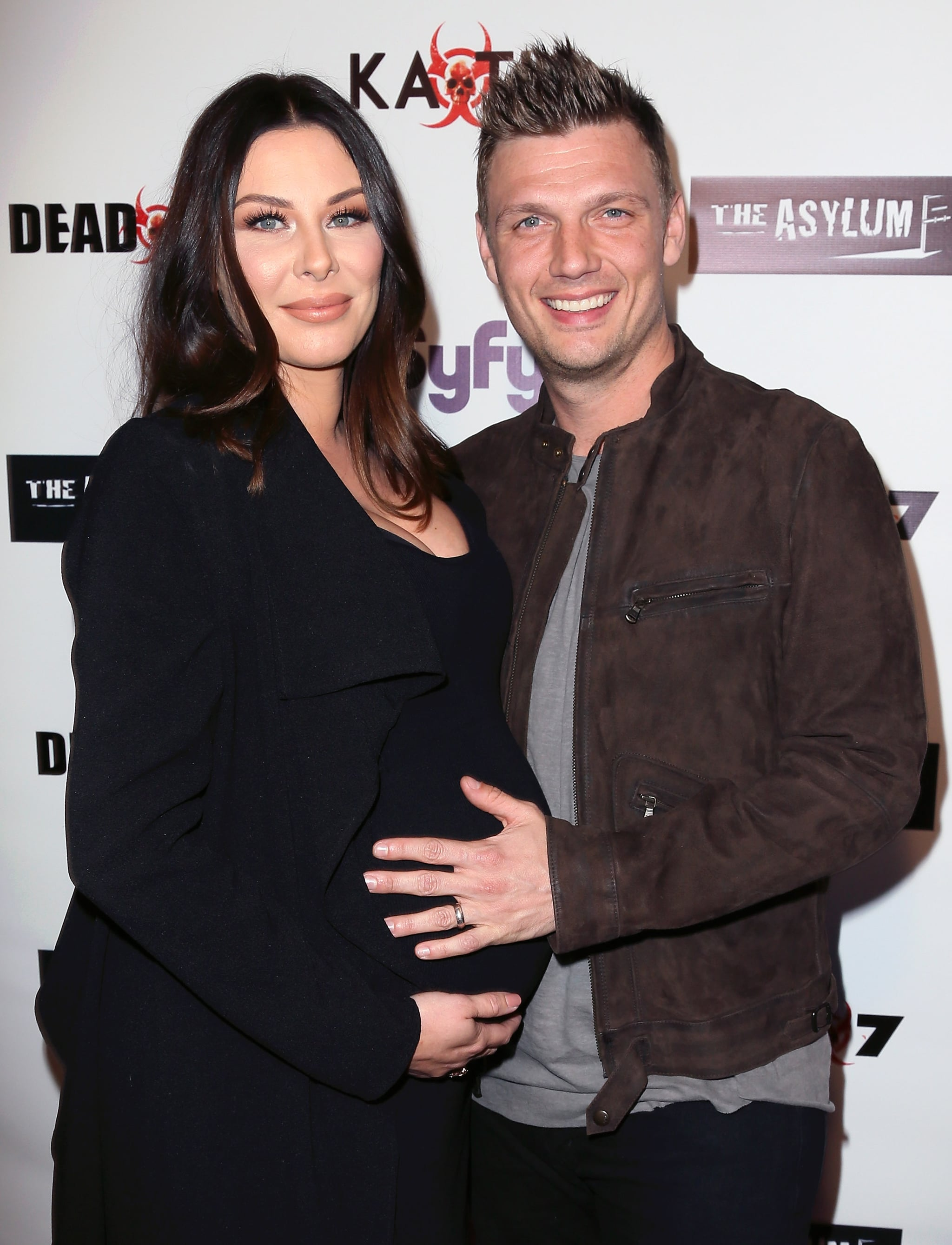 LOS ANGELES, CALIFORNIA - APRIL 01:  Singer Nick Carter (R) and wife Lauren Kitt attend the premiere of Syfy's