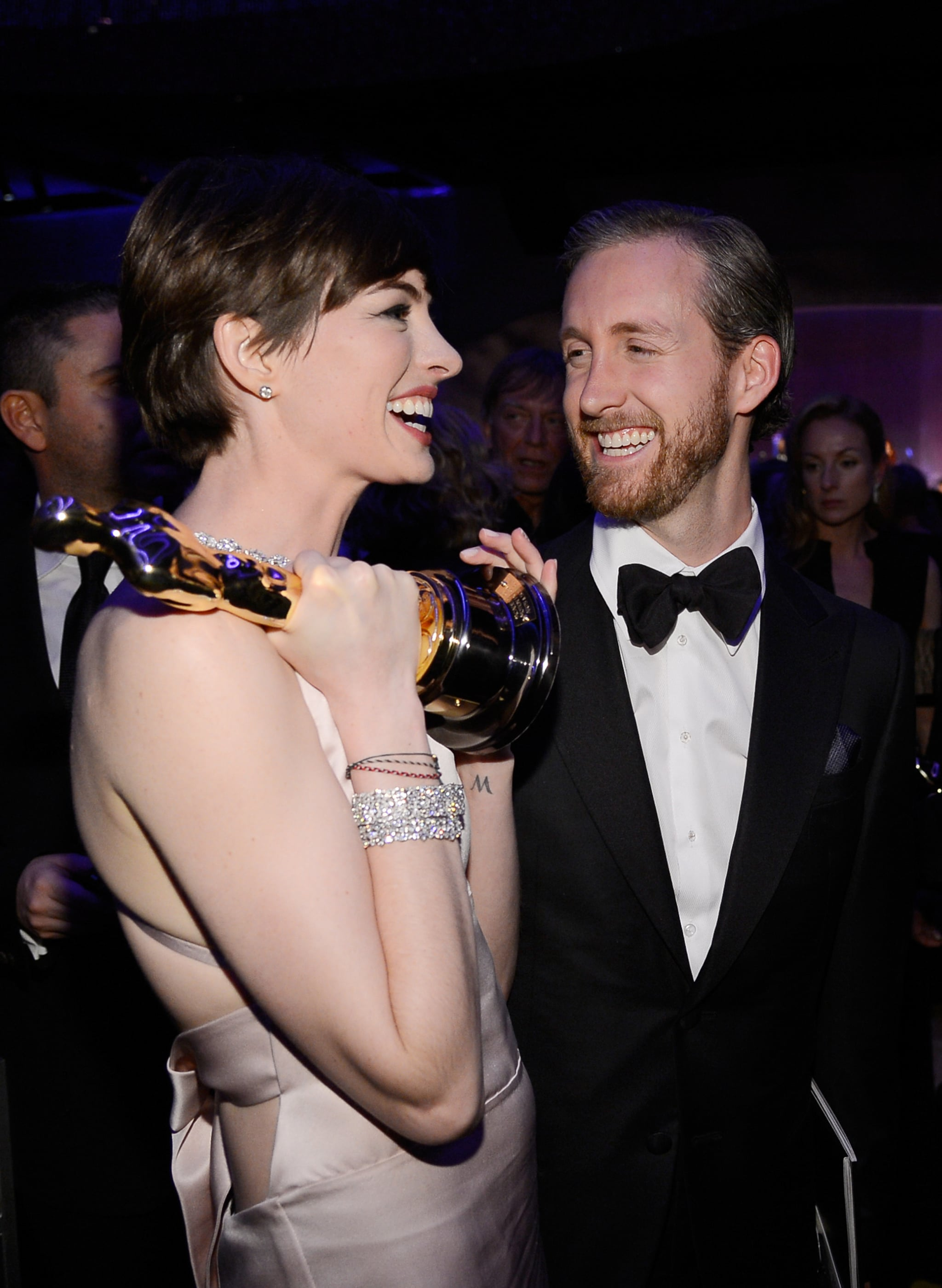 Anne Hathaway and her husband, Adam Shulman, had a laugh at the Governors Ball.
