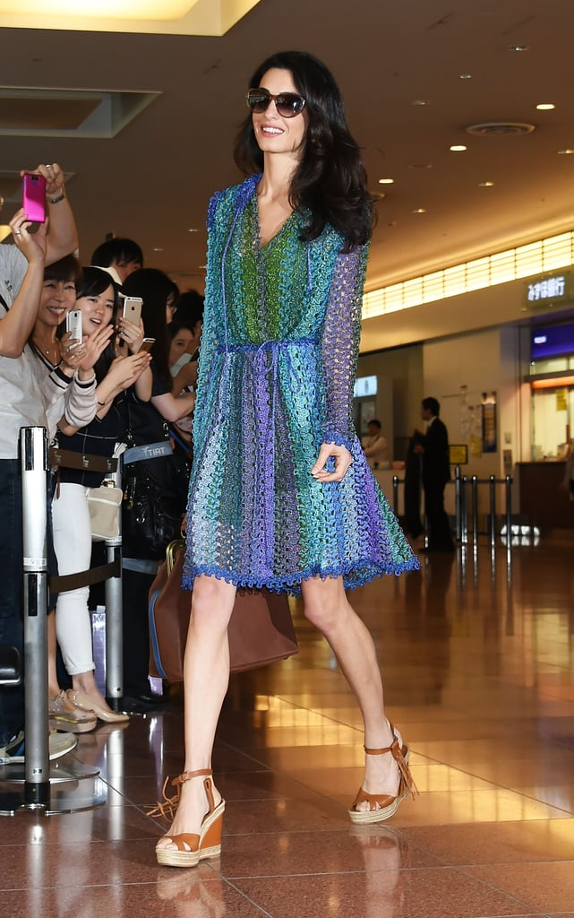 While Amal Clooney's outfit seemed impossibly chic, in reality, it only took two key pieces: a flowy, patterned dress and wedge sandals!