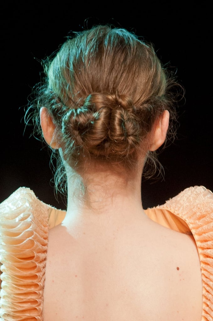 But the twisted chignon updo was the perfect style to go with the exaggerated collars designed by Georges Hobeika.
