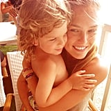 Bar Refaeli cuddled with an adorable toddler. Source: Instagram user barrefaeli