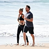 Sam Worthington and Lara Bingle walked on the beach.
