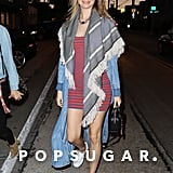 Behati Prinsloo gave us a peek at her new bump in a striped body-con minidress. She covered up in her favorite Juicy Couture duster and a fringed shawl. Behati wore an Alexander Wang chainlink choker, Alexander Wang bag, and low-top sneakers, staying true to her signature look.