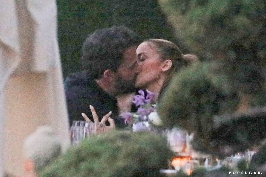 """Jennifer Lopez and Ben Affleck really want us to know they are definitely back together! After subtly confirming romance rumors with a cuddly date night earlier this month, the rekindled couple left little to the imagination as they shared a passionate kiss during a dinner date at Nobu in Malibu on Sunday. The pair were joined by J Lo's 13-year-old twins, Max and Emme, as they celebrated her sister Linda's 50th birthday. Ben and Jen were all smiles as they looked deep into each other's eyes and shared a kiss. Ben could be seen resting his hand on J Lo's back as they made their way to their car.  According to People, Ben is slowly getting to know Jennifer's kids. """"Everything seems to be running smoothly,"""" a source told the publication. """"It's very obvious that Jennifer is serious about Ben. She hasn't looked this happy for a long time."""" Another source said that Jen's kids and Ben seemed very comfortable together during their family dinner: """"The kids kept chatting with Ben. Ben seemed great. He was smiling and laughing. They ordered a lot of food to share."""" See more pictures from their PDA-filled outing ahead.       Related:                                                                                                           Wait, What? See the Celebrity Couples of 2021 Who Made Us Question Everything"""