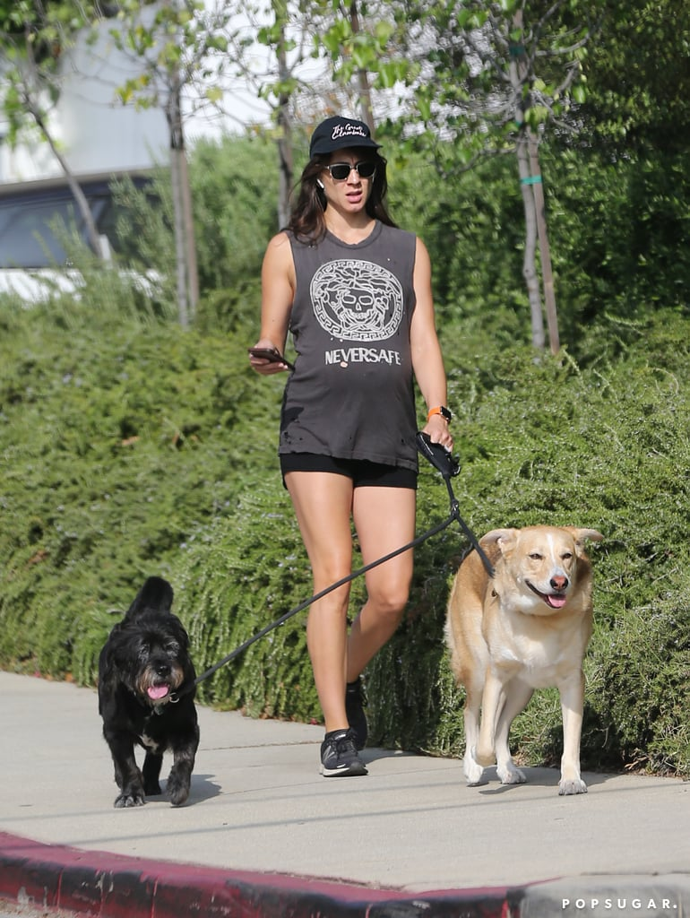 Troian Bellisario is going to be a mom! The 32-year-old actress is expecting her first child with husband Patrick J. Adams, and on Thursday, we got the first glimpse of her growing belly. The former Pretty Little Liars star covered up her bump in a tank top while taking her two dogs for a walk in LA. Troian and Patrick have been together since 2011 and tied the knot in a magical ceremony in December 2016. It's unclear how far along Troian is into her pregnancy, but we can't wait for their little one to arrive!      Related:                                                                                                           All the Celebrities Who Will Be Bringing Home New Babies!