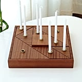 For a contemporary take on Hanukkah decor, shoppers are loving this Modular Wooden Tangram Menorah ($268).
