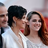 Kristen Stewart let out a few big smiles when she walked the red carpet at the Cannes Film Festival.