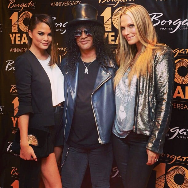 Chrissy Teigen and Molly Sims posed with Slash on the red carpet. Source: Instagram user chrissyteigen