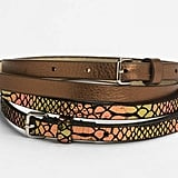 Aside from it being a pretty solid twofer, the metallic bronzed belt is a perfect offset to your khaki ankle-cut work trousers and the metallic snakeprint iteration is a more exotic office-outfit choice. Or, wear the textured belt with a long maxi skirt to give it shape and dynamic. Lodis 2-Fer Leather Belts ($52)