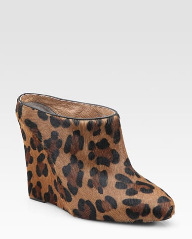 A cool wedge pair to style with tights and a leather dress.  Joie Live It Up Leopard-Print Calf Hair Wedge Mules ($265)