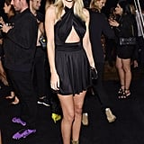 Rosie attended the Balmain x H&M launch afterparty in a cutout halter minidress and strappy sandals, both by Balmain.