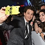 Miles Teller grabbed a cat-covered phone for a fan selfie.