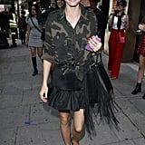 During Fashion Week Olivia contrasted her camo button-up with her tortoise oversize Zanzan sunglasses and — yes — flats!