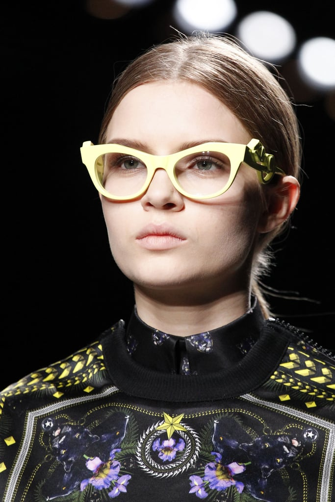 >> Fresh off the heels of the success of Prada's Spring 2011 Baroque sunglasses, Givenchy is introducing its own line of retro-inspired glasses for Fall 2011: the Panther collection. The '50s-inspired cateye glasses come in yellow, charcoal, plum, navy ($574 each), or trimmed with black fur on the frame ($640), and feature a panther on each temple piece.