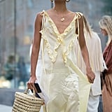 Style with a floaty day dress as a lighter alternative to leather.