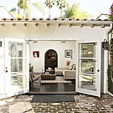 French doors open to the outside, where there's a built-in fireplace and cabana. Source: Bradley Meinz for Rodeo Realty