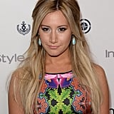 Ashley Tisdale kept thinks casual yet cute with a textured half-updo and frosty white eye shadow.