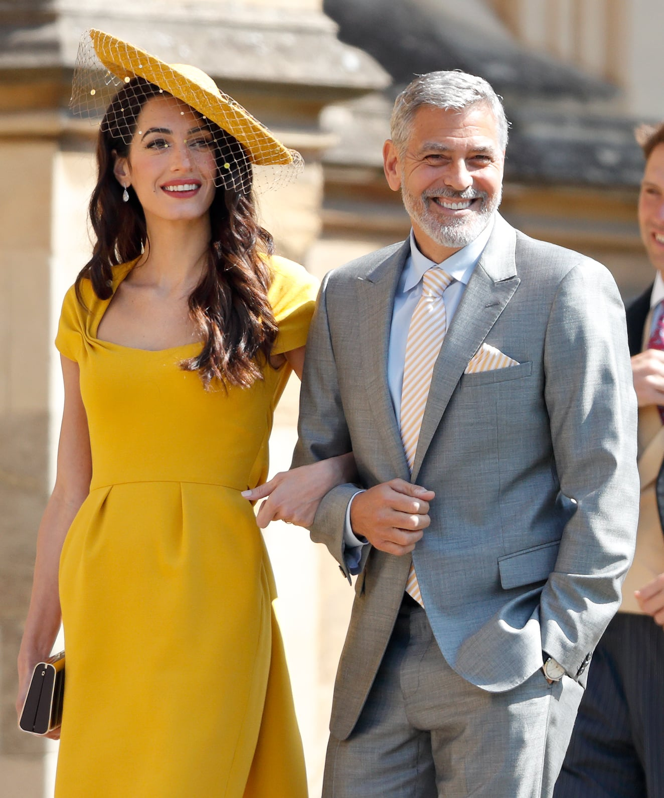 WINDSOR, UNITED KINGDOM - MAY 19: (EMBARGOED FOR PUBLICATION IN UK NEWSPAPERS UNTIL 24 HOURS AFTER CREATE DATE AND TIME) Amal Clooney and George Clooney attend the wedding of Prince Harry to Ms Meghan Markle at St George's Chapel, Windsor Castle on May 19, 2018 in Windsor, England. Prince Henry Charles Albert David of Wales marries Ms. Meghan Markle in a service at St George's Chapel inside the grounds of Windsor Castle. Among the guests were 2200 members of the public, the royal family and Ms. Markle's Mother Doria Ragland. (Photo by Max Mumby/Indigo/Getty Images)