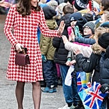 The Duchess of Cambridge greeted the crowd on Jan. 31 in a bright Catherine Walker houndstooth coat. She accessorised with a pair of fringed heels from Tod's, a Chanel bag, and a pair of pearl earrings by the Swedish brand In2Design.