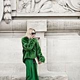 Emerald green looked utlraelegant against black tights, heels, and sunglasses.