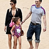 Halle Berry wore a black bikini to hit the beach in Hawaii with her daughter, Nahla, and fiancé, Olivier Martinez.
