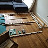 For a rougher but dramatically cheaper alternative, consider purchasing a Murphy bed hardware kit that mounts to a baseboard and pair it with this Ikea sofa.