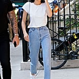 Kendall kept things simple in New York for a Tiffany & Co. photo shoot, opting for high-waisted mom jeans from Levi's, a white Re/Done tee, her Louis Vuitton x Jeff Koons Da Vinci purse, and those trusty white Adidas sneakers with a foldover strap.