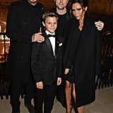 David, Victoria, and Romeo posed with Burberry designer Christopher Bailey at the launch of the brand's holiday campaign in November 2014 — Romeo starred in the ads!