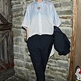 Kate Lanphear topped her slim trousers with a billowy white blouse at the Burberry bash.