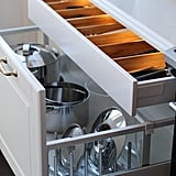 Pot and pan lids are notoriously tricky to organise, which is why this Ikea Sektion lid organiser is a must.