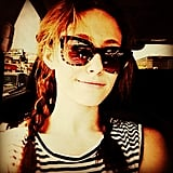 Emmy Rossum sported cute braided pigtails and sunglasses.  Source: Instagram user emmyrossum