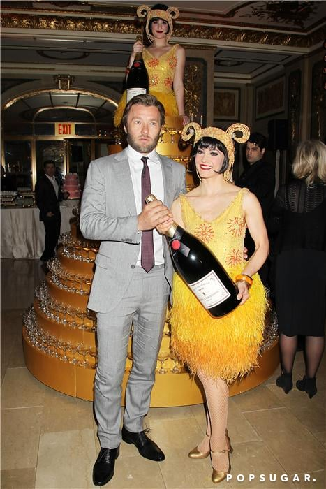 Joel Edgerton grabbed a large Champagne bottle during the afterparty.