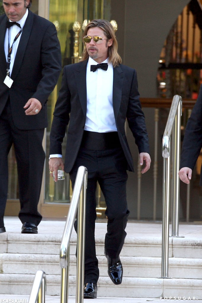 Brad Pitt carried a drink outside the Eden Roc Hotel.