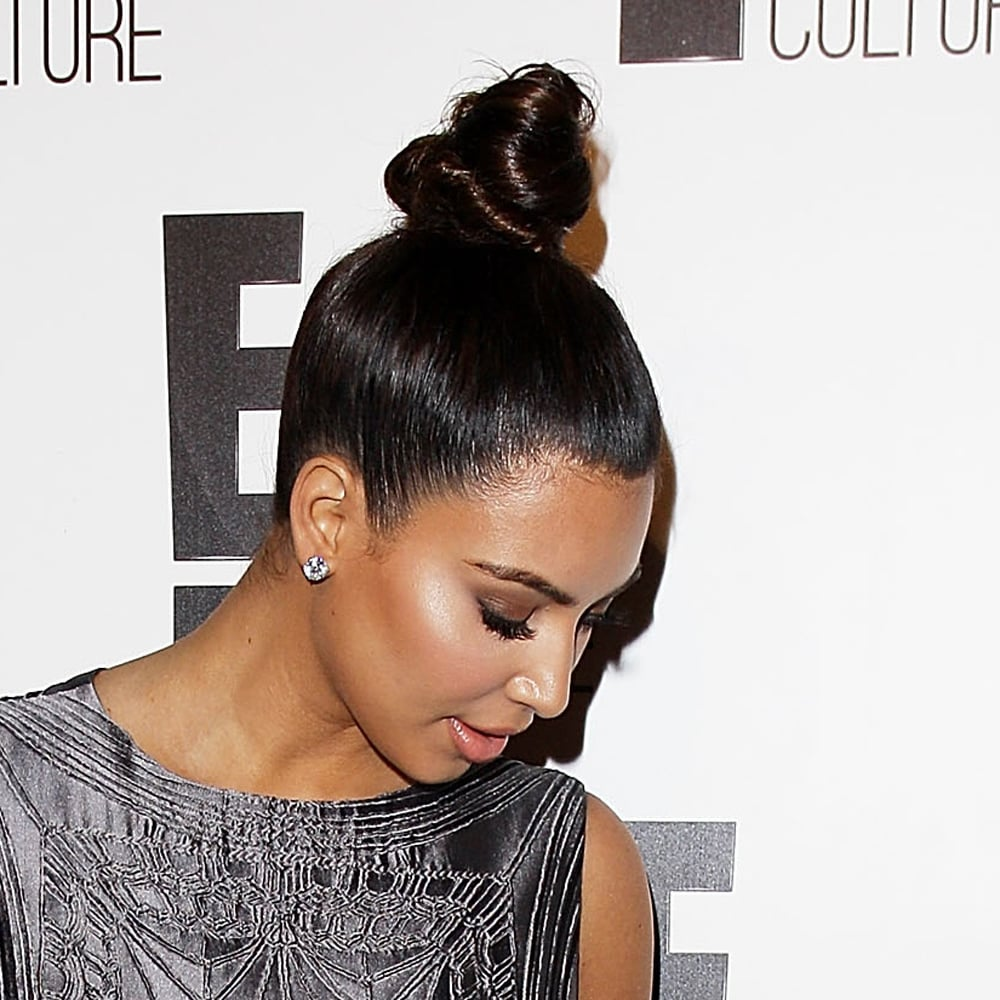 Who knew a bun could look so artistic? We've recently told you that spool-shaped top-knots are all the rage, and Kim K has further convinced us. To pull the look off, you need a high-gloss smoothing shine spray like GHD Final Shine Spray ($20). It'll smooth any fly-aways and keep you looking polished.