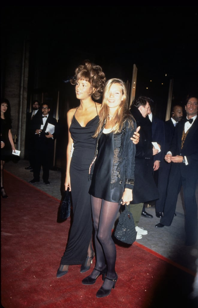 With Veronica Webb in 1994, wearing a black slip dress, a trophy jacket, and matching tights to the CFDA Awards.